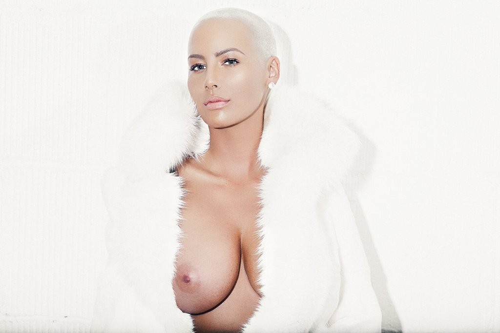 Amber rose just shared her first photos post breast reduction surgery they're sexy