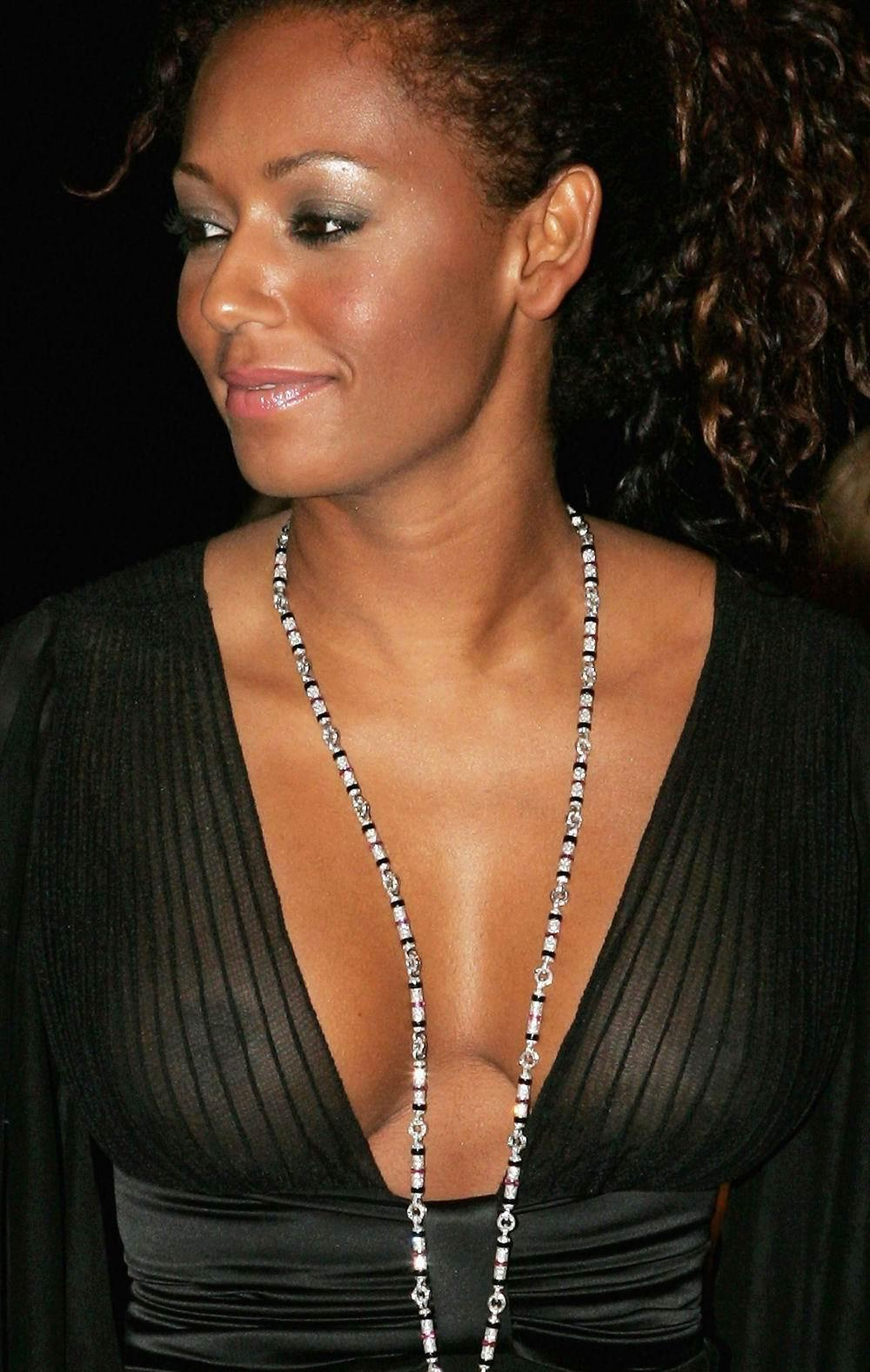 Hot cleavage and bikini photos of mel b while on a speedboat